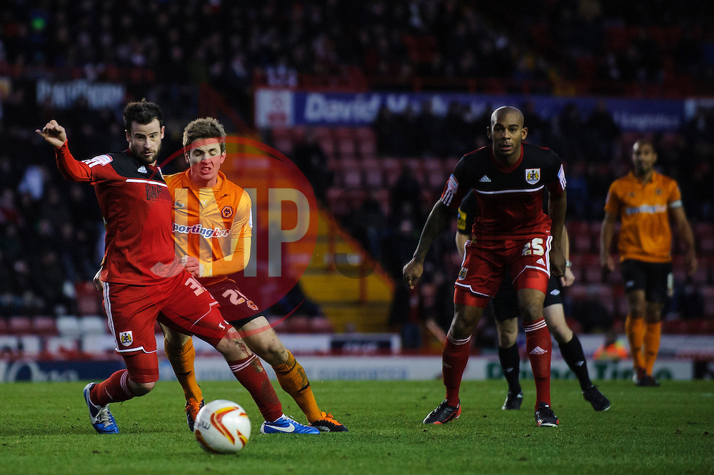 Bristol City Defender Matthew Bates (ENG) in action challenged by Wolves Forward Kevin Doyle (IRL) during the second half of the match - Photo mandatory by-line: Rogan Thomson/JMP - Tel: Mobile: 07966 386802 01/12/2012 - SPORT - FOOTBALL - Ashton Gate - Bristol. Bristol City v Wolverhampton Wanderers - npower Championship.