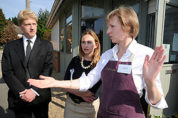©  licensed to London News Pictures. .Cray Valley,St Mary Cray,Orpington, UK.06/05/2011.Jo Johnson MP for Orpington and brother of Boris Johnson in talks with Alessandra Buonfino Head of Tesco corporate responsibility (middle) about investment into The Cray Valley in St Mary Cray,Orpington by Tesco. .Carole Wells owner of Croft Tea Rooms,St Mary Cray. (right).Please see special instructions..Picture credit should read Grant Falvey/LNP......
