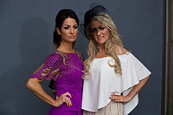 LIVERPOOL, ENGLAND - Thursday, April 6, 2017: Ellie Hoare [L], 32 from Aintree, wearing a purple dress from Virgo's Lounge, and Louise Cosgrove, 27 from Walton, wearing Boo and Misguided, during The Opening Day on Day One of the Aintree Grand National Festival 2017 at Aintree Racecourse. (Pic by David Rawcliffe/Propaganda)