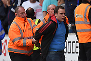 Cardiff City fan is led away by stewards after attempting to get on the pitch 1-2 during the EFL Sky Bet Championship match between Wolverhampton Wanderers and Cardiff City at Molineux, Wolverhampton, England on 19 August 2017. Photo by Alan Franklin.