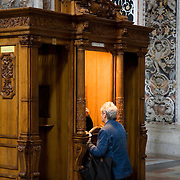 Woman and priest at confessional, Chiesa del Gesu, circa 1591, Palermo, Sicily, Italy