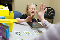 Erica Rasche attended a speech therapy session with Maddie Marshall at Southern Indiana Rehabilitation Hospital New Albany, Thursday, Feb. 11, 2016 <br /> <br /> 9 year old, Erika Rasche was diagnosed with a chromosome 9 deletion, also known as 9p Deletion Syndrome, a rare genetic condition that can cause a variety of physical abnormalities and developmental delays. Doctors also detected an intestinal malrotation, where Erika&rsquo;s intestine had failed to coil into the proper position in her abdomen. She underwent surgery to correct it.<br /> <br /> She came home from the hospital very frail about a month later &mdash; on oxygen and a feeding tube. Less than a week after that, she had to be admitted to Kosair in Louisville because her vomiting and other symptoms had worsened. There, she had to undergo open-heart surgery to correct a hole in her heart. <br /> <br /> She was finally able to return home before her first birthday to begin her recovery and start therapy. Though her heart is now &ldquo;fine,&rdquo; according to her mom, Erika has had continued problems with movement, speech and swallowing that required long-term therapy.
