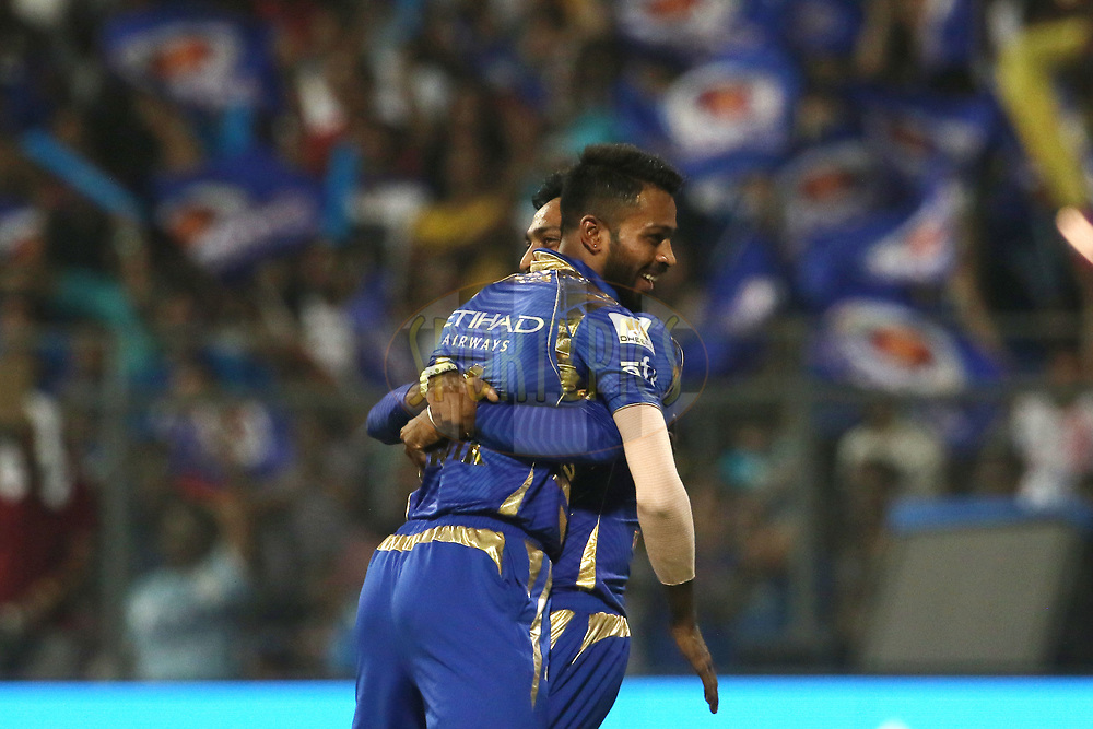 Krunal Pandya of the Mumbai Indians and Hardik Pandya of the Mumbai Indians celebrates the wicket of Robin Uthappa of the Kolkata Knight Riders during match 7 of the Vivo 2017 Indian Premier League between the Mumbai Indians and the Kolkata Knight Riders held at the Wankhede Stadium in Mumbai, India on the 9th April 2017<br /> <br /> Photo by Vipin Pawar - IPL - Sportzpics