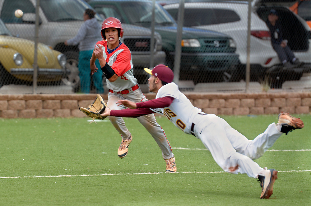 gbs042517h/SPORTS -- Valley pitcher Daniel Romero-Martinez dives and catches the pop fly of West Mesa's Diego Armijo as West Mesa's Gabe Ramirez,4, runs towards home in the first inning. Romero-Martinez then caught Ramirez off of third for a double play during the game at Valley on Tuesday, April 25, 2017.  (Greg Sorber/Albuquerque Journal)