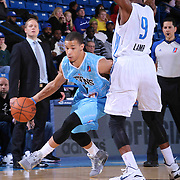 Delaware 87ers Guard Jared Cunningham (17) drives past Texas Legends Guard Doron Lamb (9) in the first half of a NBA D-league regular season basketball game between the Delaware 87ers and the Texas Legends (Dallas Mavericks) Sunday, Jan. 25, 2015 at The Bob Carpenter Sports Convocation Center in Newark, DEL