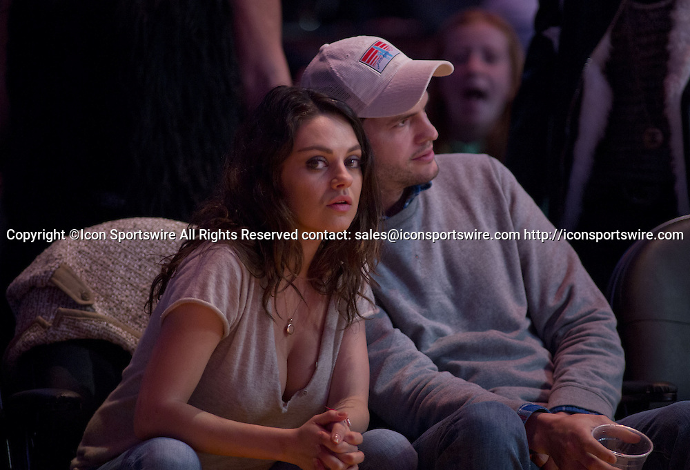 Dec. 19, 2014 - Los Angeles, California, U.S - Mila Kunis (L) and Ashton Kutcher attend the basketball game between the Oklahoma City Thunder and the Los Angeles Lakers at Staples Center on Friday December 19, 2014 in Los Angeles, California