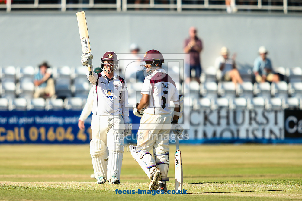 Rob Newton of Northamptonshire CCC (left) acknowledges the applause on reaching his double-century during the Specsavers County C'ship Div Two match at the County Ground, Northampton<br /> Picture by Andy Kearns/Focus Images Ltd 0781 864 4264<br /> 15/08/2016
