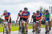 Nederland, Garyp, 14-07-2018<br /> Op de snelweg N31 bij Garyp rijden fietsers mee met de Elfwegentocht, wat de grootste parade van duurzame voertuigen moet zijn.<br /> <br /> Cyclists participate at the Elfwegentocht (eleven city tour) at the highway N31 near Gary. The tour is supposed to be the largest parade of sustainable vehicles.<br /> Foto: Bas de Meijer / De Beeldunie