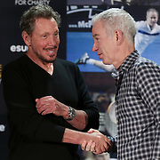 February 28, 2014, Palm Springs, California: <br /> Tournament owner Larry Ellison shakes hands with John McEnroe during the McEnroe Challenge for Charity VIP Draw Ceremony in the newly constructed Stadium 2 at the Indian Wells Tennis Garden. <br /> (Photo by Billie Weiss/BNP Paribas Open)