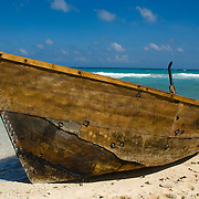 Cuban refugee boat on beach. Isla Mujeres, Quintana Roo. Mexico.