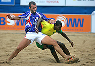 09 December 2006, Frances Didier Samoun fouls Brazils Daniel Nogueira during their game at the Vodacom Pro Beach Soccer Tour in Durban's Bay of Plenty on Saturday. Brazil won the game 9-5. Picture: Shayne Robinson, PhotoWire Africa