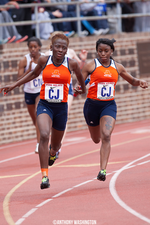 Ekundayo Sogbesan of Morgan State University grabs the baton from teammate Charisma Green during the College Women's 4x100 (Heats)at the Penn Relays athletic meets on Thursday, April 26, 2012 in Philadelphia, PA.
