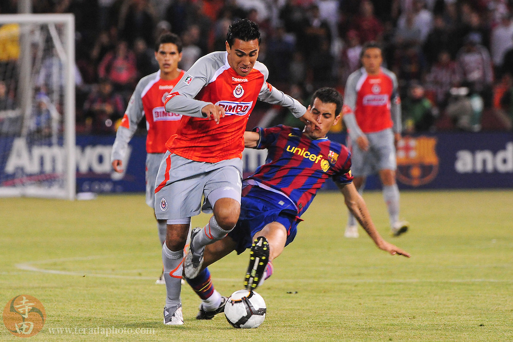 August 8, 2009; San Francisco, CA, USA; Chivas de Guadalajara forward Jesus Padilla (15, left) fights for the ball with FC Barcelona midfielder Sergi Busquets (16, right) during the second half in the Night of Champions international friendly contest at Candlestick Park. The game ended in a 1-1 tie.
