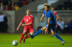 SWANSEA, ENGLAND - Friday, September 4, 2009: Wales' Simon Church and Italy's Gabriele Angella during the UEFA Under 21 Championship Qualifying Group 3 match at the Liberty Stadium. (Photo by David Rawcliffe/Propaganda)