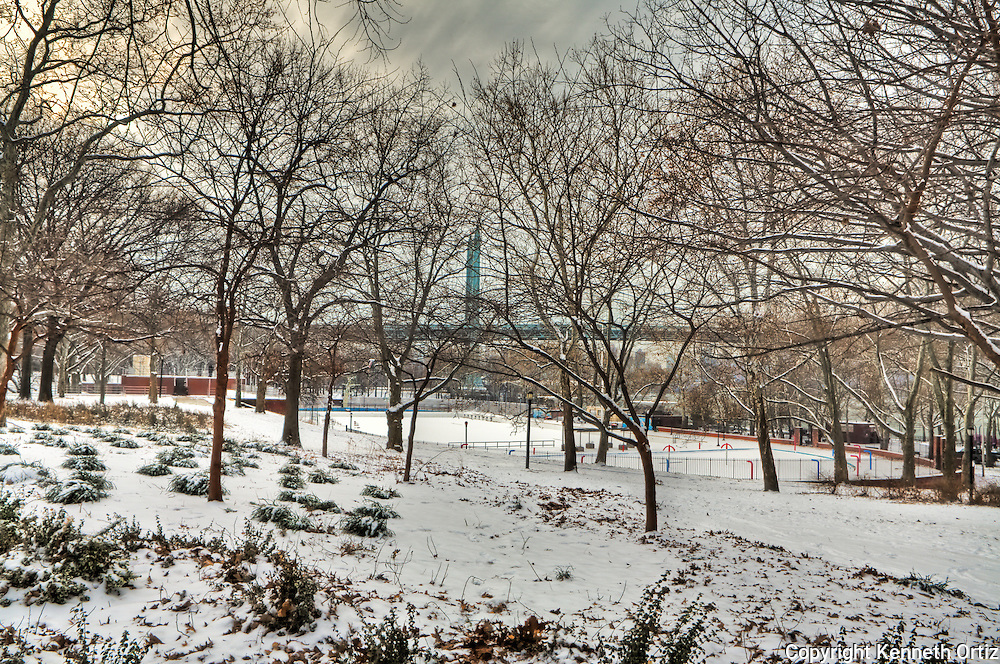 Another view of Astoria park during the winter of 2009.  In the background the RFK/Triboro Bridge can be seen as well as the Park pool which happens to be full of snow.