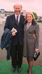 MR CHRIS WRIGHT chairman of the Chrysalis Group PLC and MRS JANICE STINNES at a race meeting in Surrey on 23rd April 1999.MRI 13