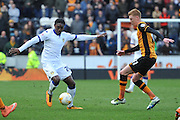 Jordan Botaka (20) of Leeds United under attack from Hull City midfielder Sam Clucas (11) during the Sky Bet Championship match between Hull City and Leeds United at the KC Stadium, Kingston upon Hull, England on 23 April 2016. Photo by Ian Lyall.