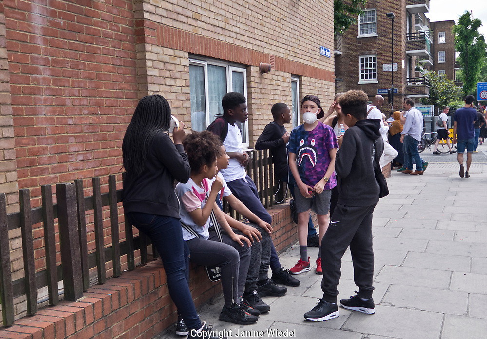 Youths from the community of Latimer Road in the aftermath of the fire