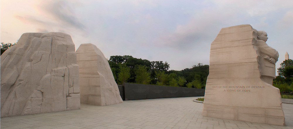 """WASHINGTON (July 19, 2011) -- At the entry portal of the Martin Luther King Jr., Memorial, two stones are parted and a single stone is pushed forward appearing as the missing piece of what was once a single boulder. On the one side, the theme of hope is presented, with the text from King's 1963 speech cut sharply into the stone: """"With this faith, we will be able to hew out of the mountain of despair a stone of hope."""" On the other side are inscribed these words: """"Let justice roll down like waters and righteousness like a mighty stream.""""  To commemorate the life and work of Dr. Martin Luther King, Jr., the creation of a memorial to honor his national and international contributions to world peace through non-violent social change is happening in Washington, DC.  Located in West Potomac Park, the Martin Luther King, Jr. National Memorial looks to perform an official dedication on Sunday, August 28, 2011, the 48th anniversary of the March on Washington and Dr. King's historic I Have A Dream speech.  Photo by Johnny Bivera"""