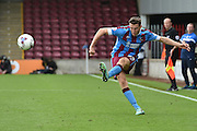 Murray Wallace  kicks ball forward during the Sky Bet League 1 match between Scunthorpe United and Blackpool at Glanford Park, Scunthorpe, England on 5 September 2015. Photo by Ian Lyall.