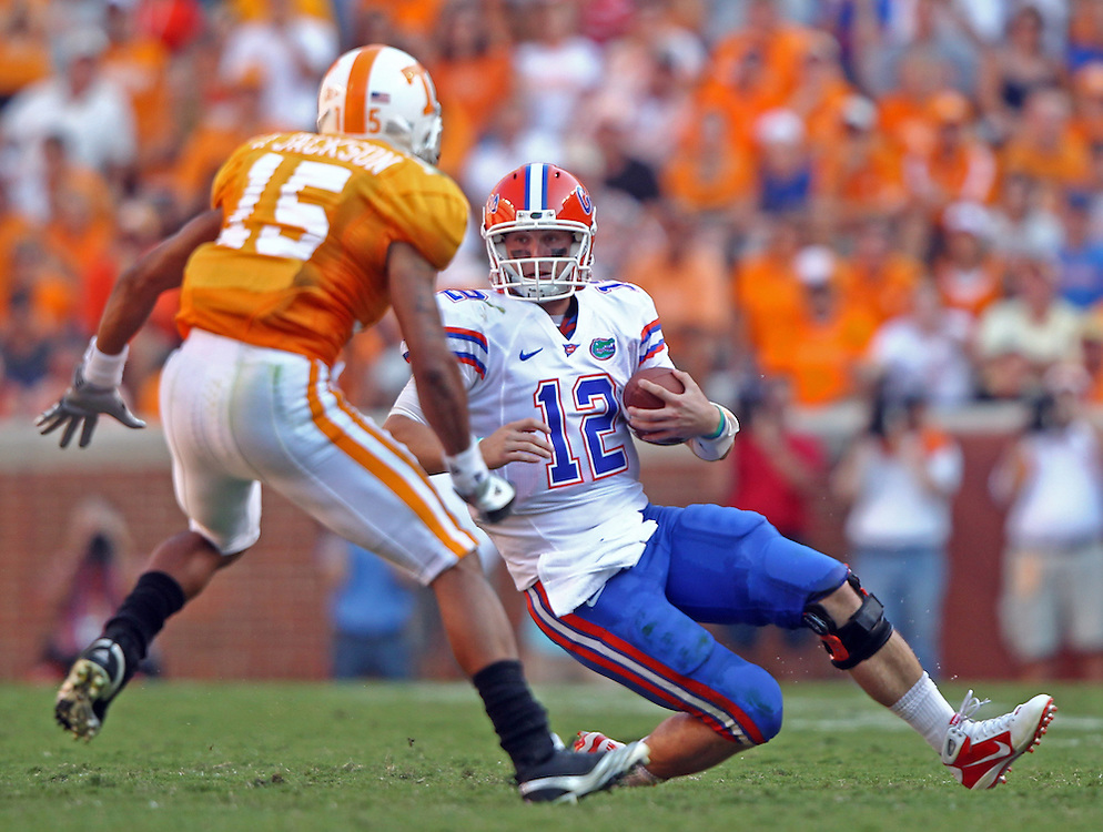 September 18,2010: Florida Gators quarterback John Brantley (12) slides to the ground after a run in front of Tennessee Volunteers cornerback Janzen Jackson (15) during the game at Neyland Stadium in Knoxville, Tennessee. The Gators won, 31-17.