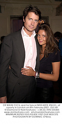 DR MARK CECIL and his fiancŽ MISS KATIE ANGEL, at a party in London on 8th February 2001.	OLE 68