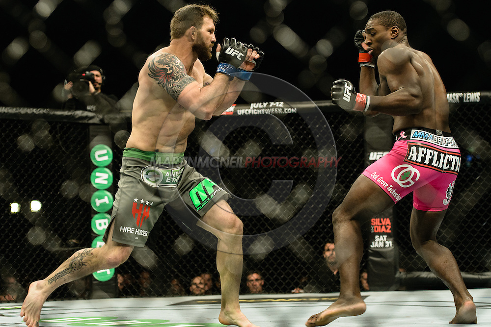 "STOCKHOLM, SWEDEN, JANUARY 24, 2015: Ryan Bader and Phil Davis during ""UFC on Fox 14: Gustafsson vs. Johnson"" inside Tele2 Arena in Stockholm, Sweden"
