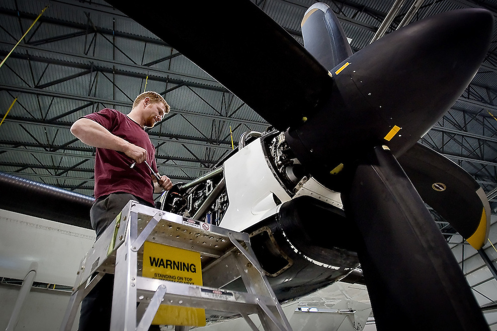 JEROME A. POLLOS/Press..Orin Luther-Lund, a mechanic with Empire Airlines in Hayden, works on an engine of a FedEx cargo plane Thursday.  Empire Airlines is concerned that the FAA Reauthorization Act will have a detrimental effect on its business.