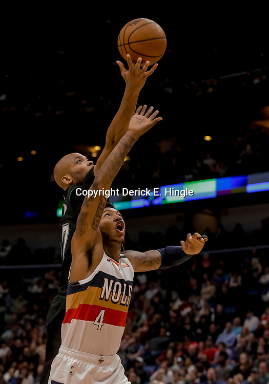 Dec 31, 2018; New Orleans, LA, USA; Minnesota Timberwolves forward Taj Gibson (67) rebounds over New Orleans Pelicans guard Elfrid Payton (4) during the first quarter at the Smoothie King Center. Mandatory Credit: Derick E. Hingle-USA TODAY Sports