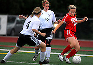 1 MAY 2010 -- O'FALLON, MO. -- Ursuline Academy girls' soccer player Casey Chalupny (38) battles Francis Howell North's Megan Frkovic (4, CQ) and Maddie McMillen (12) for control of the ball during the championship game of the 19th Annual St. Dominic / Howell North Shootout Saturday, May 1, 2010 at St. Dominic High School in O'Fallon, Mo. Ursuline beat Howell North 2-1. Photo © copyright 2010 by Sid Hastings.