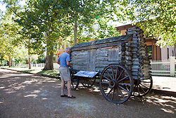 Springfield, IL:  A campaign wagon give some historic context to the main avenue of the Lincoln National Historic Site, a preservation of four city blocks that resembles the 1845-65 period.