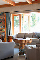 A solar home on Saltspring Island built by NZ Builders operates independantly from the energy grid, using active and passive solar energy, collecting water from the roof and built using concrete insulated panels.  The relaxed living area is cool in summer and warm in winter.