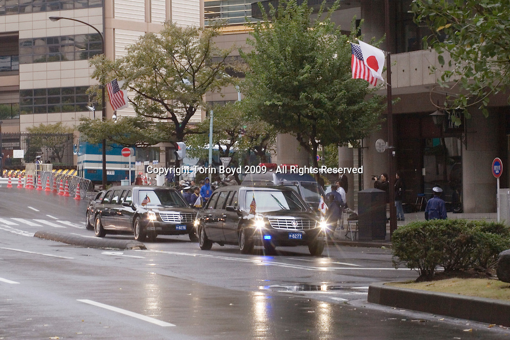 This is US President Barack Obama's limousine and motorcade passing in front of United States Embassy in Tokyo on November 14, 2009 (Obama's limo is the second limo). President Obama made this brief visit to Japan, his first as a US President. When he arrived Tokyo on Fri. Nov,13 he immediately held a summit with new Japanese Prime Minister Yukio Hatoyama. In addition to the talks with PM Hatoyama, on his second and final day in Japan (11/14/09), Mr. Obama gave a speech on Asian policy to invited guests and then met with Japanese Emperor Akihito and Empress Michiko for lunch. After Japan, Obama will travel to Singapore to attend the 2009 APEC summit in Singapore and afterwards will visit China and Korea.