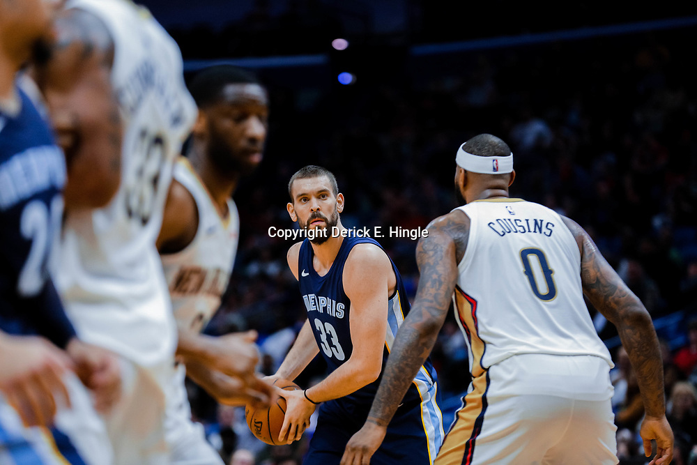 Jan 20, 2018; New Orleans, LA, USA; Memphis Grizzlies center Marc Gasol (33) is defended by New Orleans Pelicans center DeMarcus Cousins (0) during the first half at the Smoothie King Center. Mandatory Credit: Derick E. Hingle-USA TODAY Sports