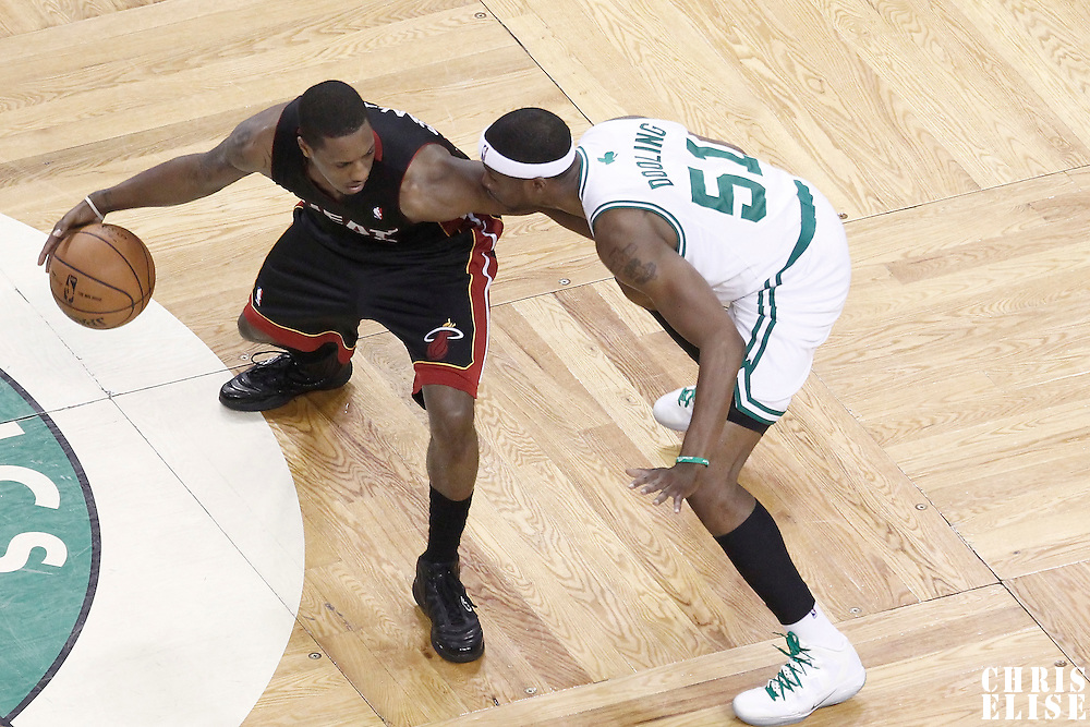 03 June 2012: Boston Celtics point guard Keyon Dooling (51) defends on Miami Heat point guard Mario Chalmers (15) during the second quarter of Game 4 of the Eastern Conference Finals playoff series, Heat at Celtics, at the TD Banknorth Garden, Boston, Massachusetts, USA.