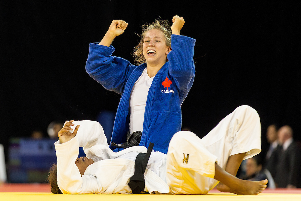 Catherine Beauchemin-Pinard celebrates her win over Rafaela Silva of Brazil  in their final of the table in the 57kg class at the 2015 Pan American Games in Toronto, Canada, July 12,  2015. AFP PHOTO/GEOFF ROBINS