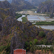 View of Khao Sam Roi Yod National Park, Thailand,  showing the mountains, temple and fields and paddies.