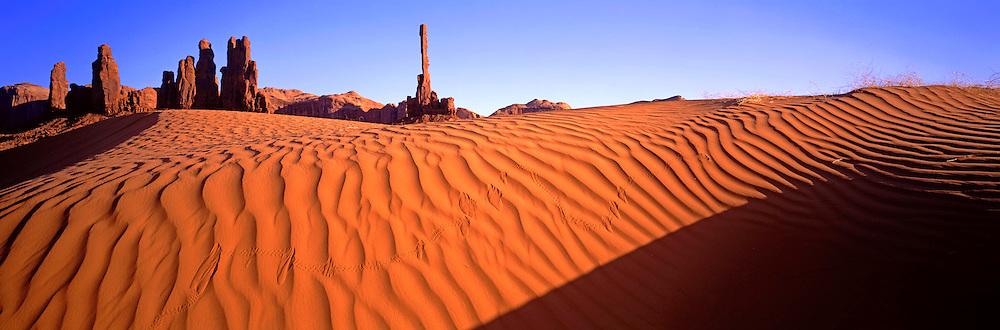 ARIZONA, MONUMENT VALLEY sand dunes below Totem Pole Rock