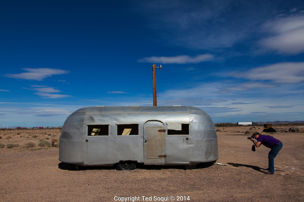 AN old Airstream trailer.<br /> U.S. Route 66, also known as the Mother Road, in the Mojave desert of California. The two major connector cites in the Mojave desert are Barstow and Amboy. U.S. Route 66 was the first major east west highway for the US, starting in Chicago, Il and ending in Santa Monica, CA. The 2,448 mile long highway was built in November 11,1926. Most of Route 66 has been decommissioned, but there are several parts that are now historically preserved.
