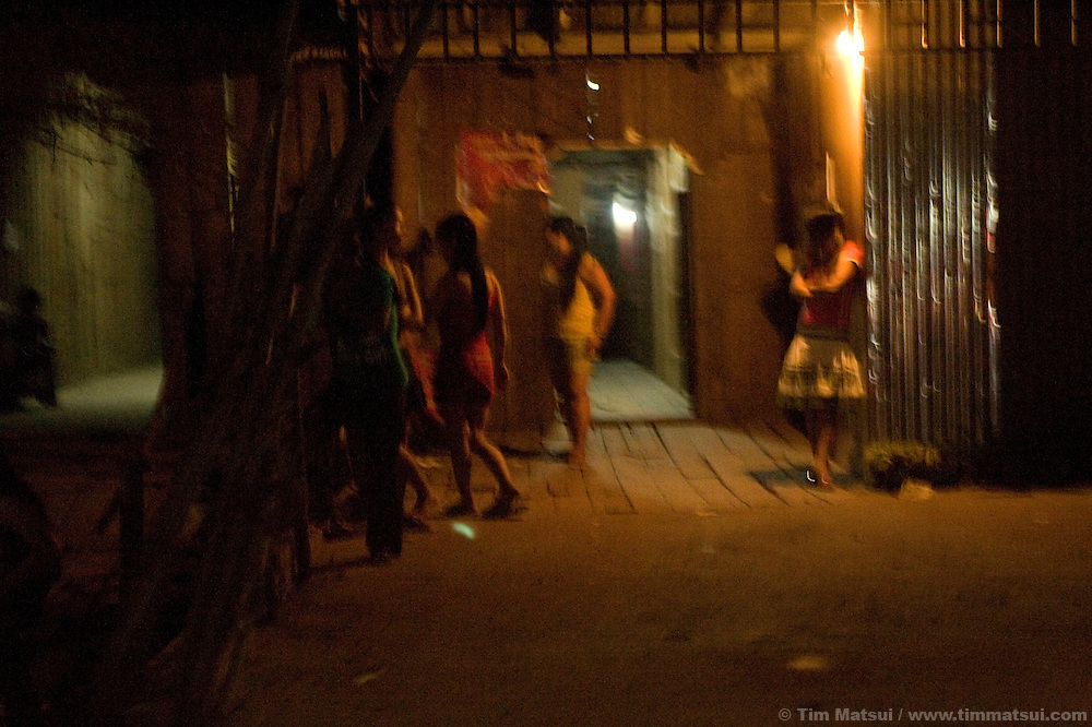 Prostitutes wait for Cambodian clients outside makeshift brothels, often just restaurants, homes, or small businesses, in the Phnom Penh neighborhood of Toul Kork.