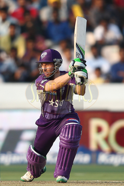 Jon Wells of the Hobart Hurricanes looks for a run during the first semi final match of the Oppo Champions League Twenty20 between the Kolkata Knight Riders and the Hobart Hurricanes held at the Rajiv Gandhi Cricket Stadium, Hyderabad, India on the 2nd October 2014<br /> <br /> Photo by:  Shaun Roy / Sportzpics/ CLT20<br /> <br /> <br /> Image use is subject to the terms and conditions as laid out by the BCCI/ CLT20.  The terms and conditions can be downloaded here:<br /> <br /> http://sportzpics.photoshelter.com/gallery/CLT20-Image-Terms-and-Conditions-2014/G0000IfNJn535VPU/C0000QhhKadWcjYs