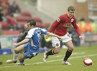 Photo: Aidan Ellis.<br /> Wigan Athletic v Manchester United. The Barclays Premiership. 14/10/2006.<br /> United's Ole Gunnar Solskjaer beats Wigan's leighton Baines