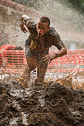 Paul Anderson competes in the 5K Mud Run during the 7th Annual Malibu Canyon Dirt Dash on Saturday, September 22, 2012. The event was presented by The Salvation Army and featured various obstacles such as rope climbs, swings, bridge crossings and mud pit.