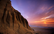 On Gale beach, a beautiful sunset is improved by the presence of the magnificent sandstone cliffs