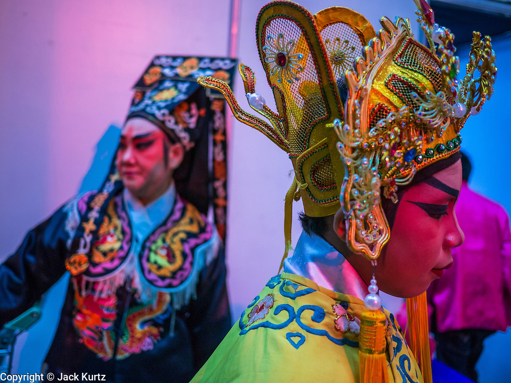 08 FEBRUARY 2013 - BANGKOK, THAILAND:  Chinese opera performers wait to go on stage for a Chinese New Year performance at Seacon Square in Bangkok. Chinese opera is popular in Thailand and is usually performed in the Teochew language. The weeks surrounding Chinese New Year are important for retailers in Thailand and many malls put on special promotions and events honoring Chinese culture, like Lion Dances or Chinese Opera. Thailand has a large Thai-Chinese population. Millions of Chinese emigrated to Thailand (then Siam) in the 18th and 19th centuries and brought their cultural practices with them.   PHOTO BY JACK KURTZ