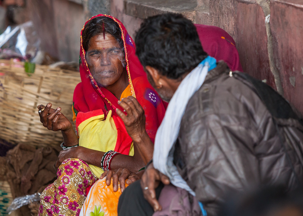 A woman smoking in a market in Jjaipur, India.