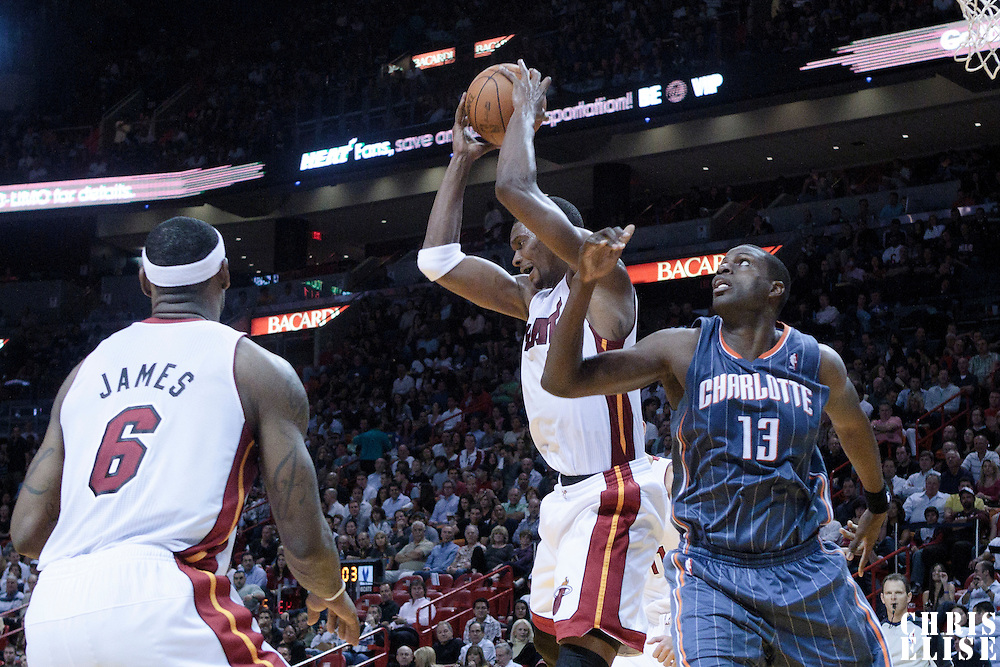19 November 2010: Miami Heat's power forward #1 Chris Bosh grabs a rebound over Charlotte Bobcats' center #13 Nazr Mohammed during the Miami Heat 95-87 victory over the Charlotte Bobcats at the AmericanAirlines Arena, Miami, Florida, USA.