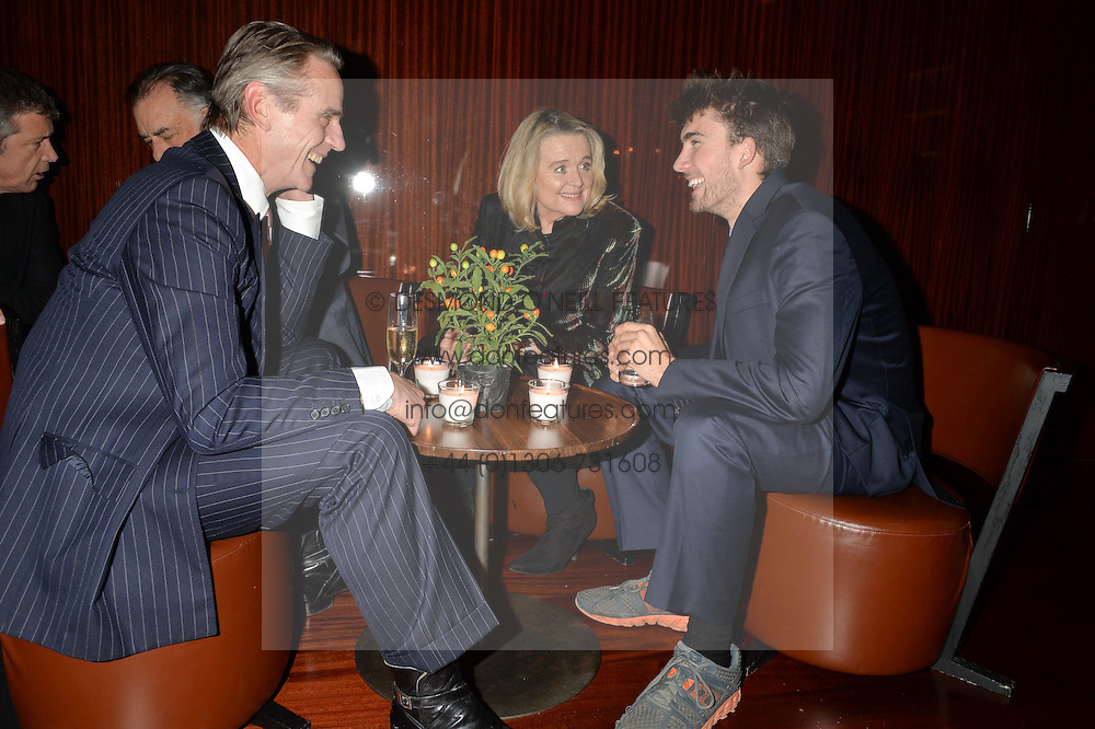 Left to right, JEREMY IRONS, SINEAD CUSACK and BAILEY COPPOLA at a dinner hosted by Liberatum to honour Francis Ford Coppola held at the Bulgari Hotel & Residences, 171 Knightsbridge, London on 17th November 2014.