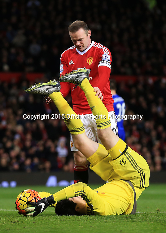 16 December 2015 - Barclays Premier League - Manchester United v Chelsea - Wayne Rooney of Manchester United holds onto the legs of Chelsea goalkeeper Thibaut Courtois - Photo: Marc Atkins / Offside.