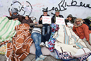 Tunis, Tunisia. January 25th 2011.Protesters in front of the Prime Minister's office (Mohammed Ghannouchi) on the Kasbah Square as they demand the removal of members of the ousted president's regime (Zine El Abidine Ben Ali) still in the government. Many people, bundled up in blankets, slept outside the prime minister's office overnight, in defiance of a curfew initiated in response to unrest that forced President Zine El Abidine Ben Ali to flee Tunisia on January 14th......